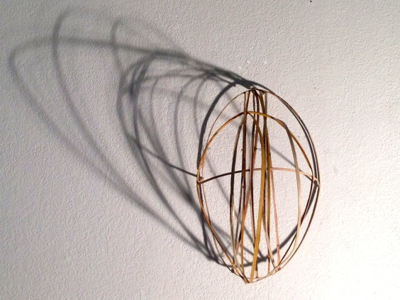 Lauren A. Toomer, Untitled (mask), 2013. Bamboo strips and wood stain