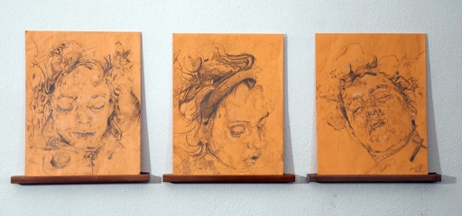 Lauren A. Toomer, Fayum series (#1, #6, #2)   Portrait installation). 2010 - Present| Graphite and white charcoal on found manila envelope, resting on wood shelf|14 x 10 inches each ( triptych instillation 14 x 30 inches),